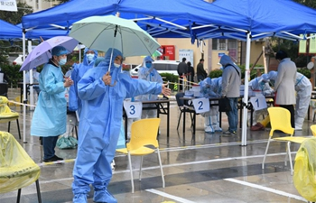 In pics: nucleic acid testing in Qingdao, Shandong