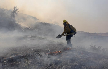 Raging wildfires injure two firefighters in California, force massive evacuations