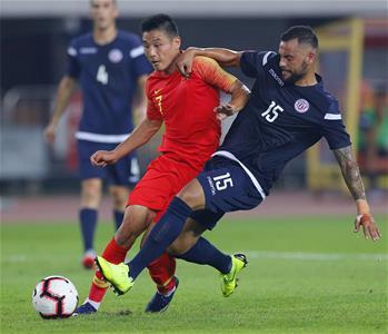 足球——世預賽:中國隊勝關島隊