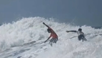菲律賓:衝浪選手放棄比賽 勇救落水對手