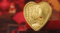 """將愛收藏:央行發行""""520心形紀念幣"""""""