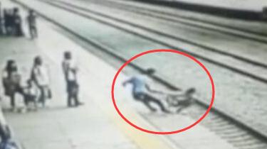 福建仙遊:女孩輕生 火車站客運員飛身救人