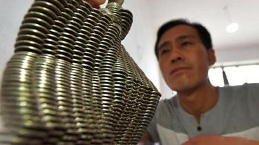 河北:農民酷愛硬幣藝術 各種造型