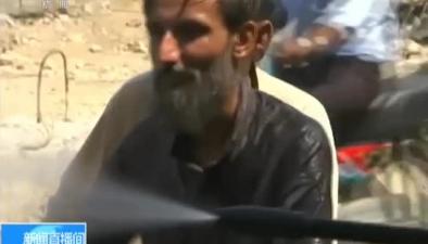 巴基斯坦:熱浪侵襲 民眾街頭淋水降溫