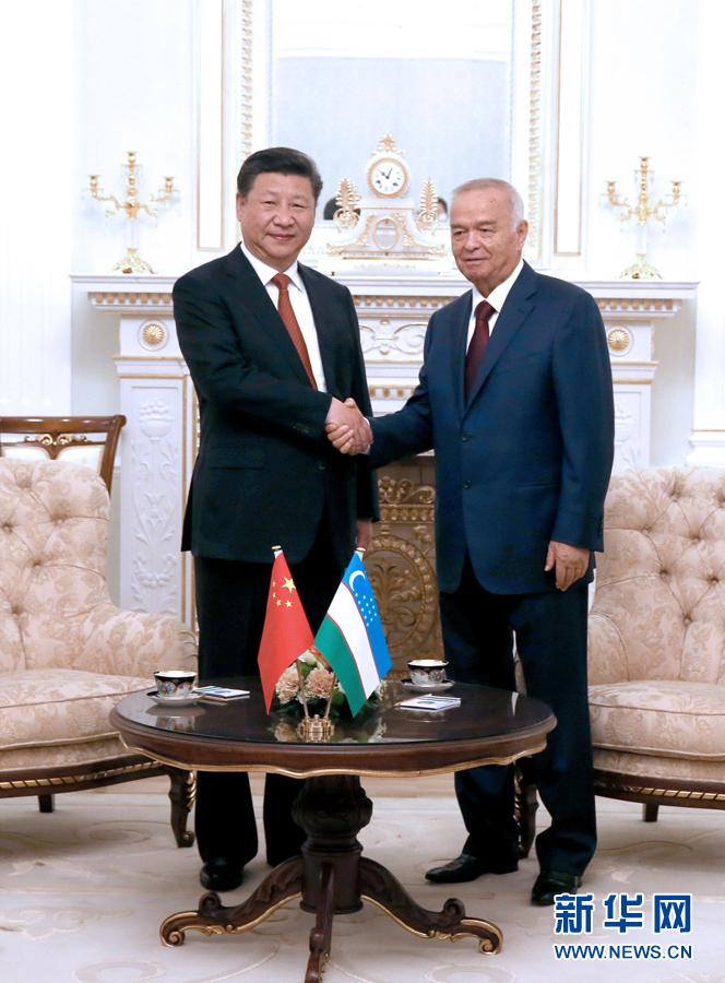 6月22日,國家主席習近平在塔什幹庫克薩萊國賓館同烏茲別克斯坦總統卡裏莫夫舉行會談。 新華社記者馬佔成攝
