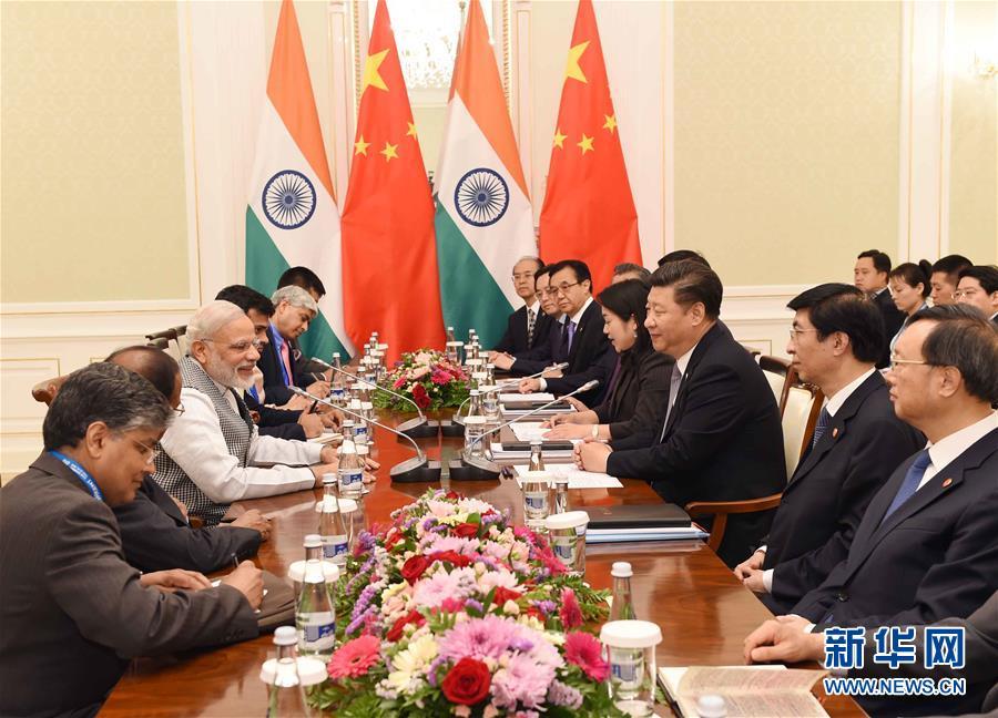 6月23日,國家主席習近平在烏茲別克斯坦塔什幹會見印度總理莫迪。新華社記者 饒愛民攝