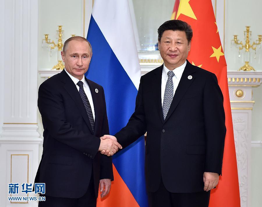 6月23日,國家主席習近平在烏茲別克斯坦塔什幹會見俄羅斯總統普京。新華社記者李濤攝