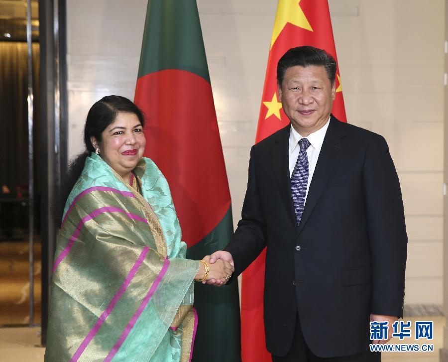 10月14日,國家主席習近平在達卡會見孟加拉國國民議會議長喬杜裏。 新華社記者蘭紅光攝