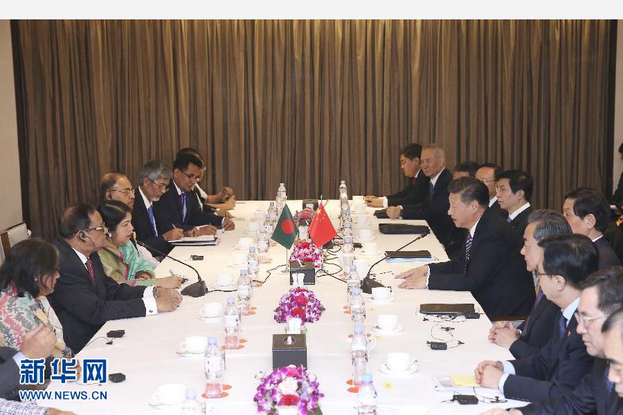 10月14日,國家主席習近平在達卡會見孟加拉國國民議會議長喬杜裏。 新華社記者龐興雷攝