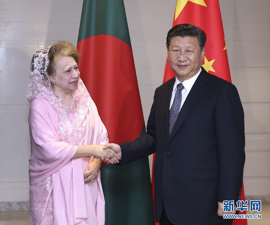 10月14日,國家主席習近平在達卡會見孟加拉國民族主義黨主席卡莉達·齊亞。  新華社記者龐興雷攝