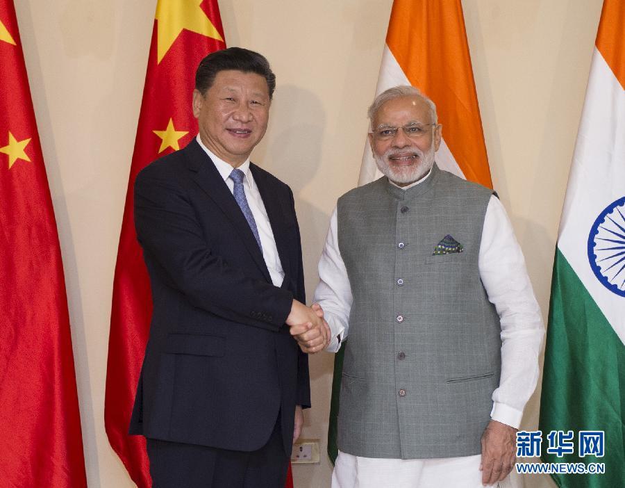 10月15日,國家主席習近平在印度果阿會見印度總理莫迪。新華社記者謝環馳攝