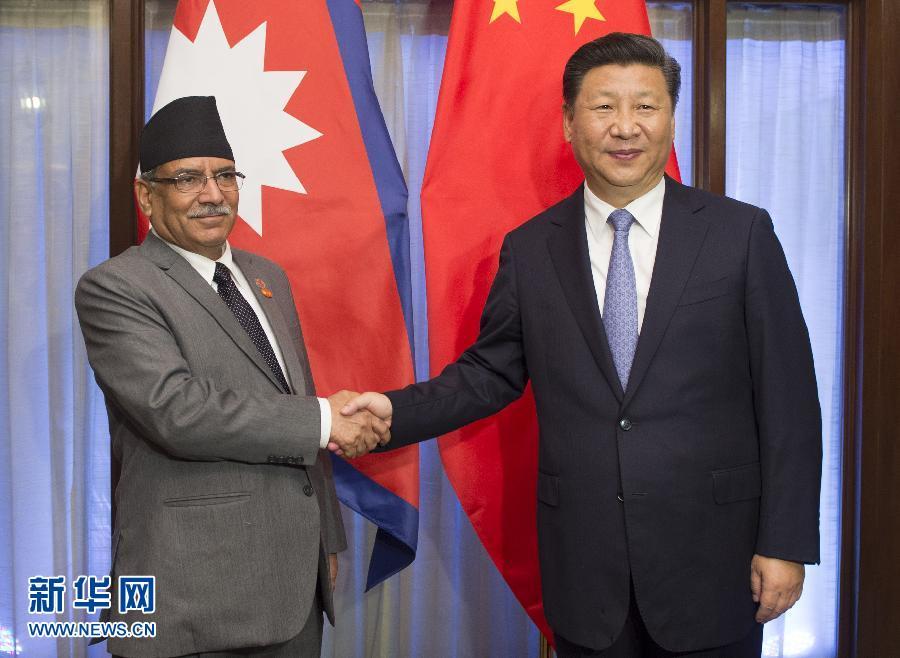 10月15日,國家主席習近平在印度果阿會見尼泊爾總理普拉昌達。新華社記者謝環馳攝
