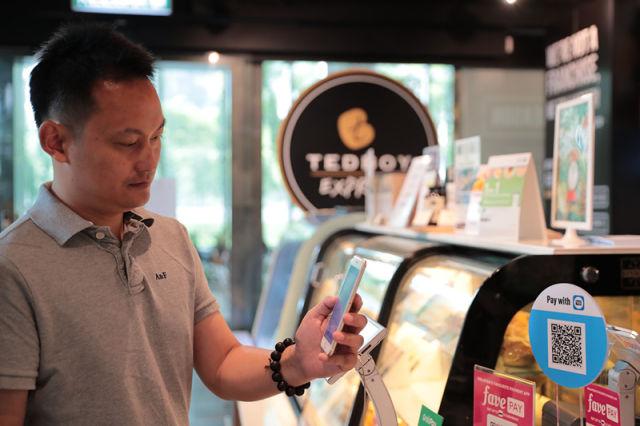 马来西亚能刷手机坐地铁了!当然少不了中国技术的助推