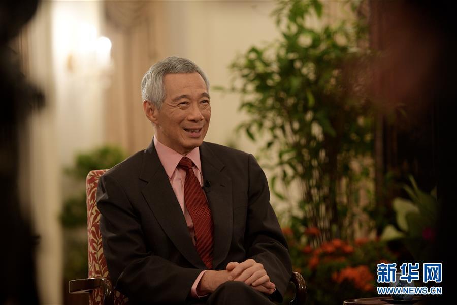"""(國際·""""一帶一路""""高峰論壇·圖文互動)重慶互聯互通示范項目可為區域國家發展提供服務——訪新加坡總理李顯龍"""