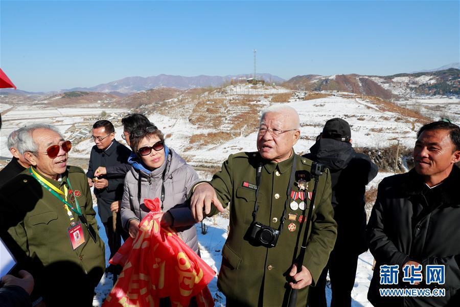 (國際·圖文互動)(1)通訊:登上松骨峰 祭奠最可愛的人