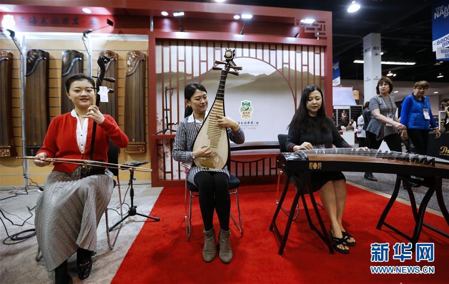 """(国际·图文互动)(3)通讯:中国乐器在美国乐器展上""""奏响强音"""""""