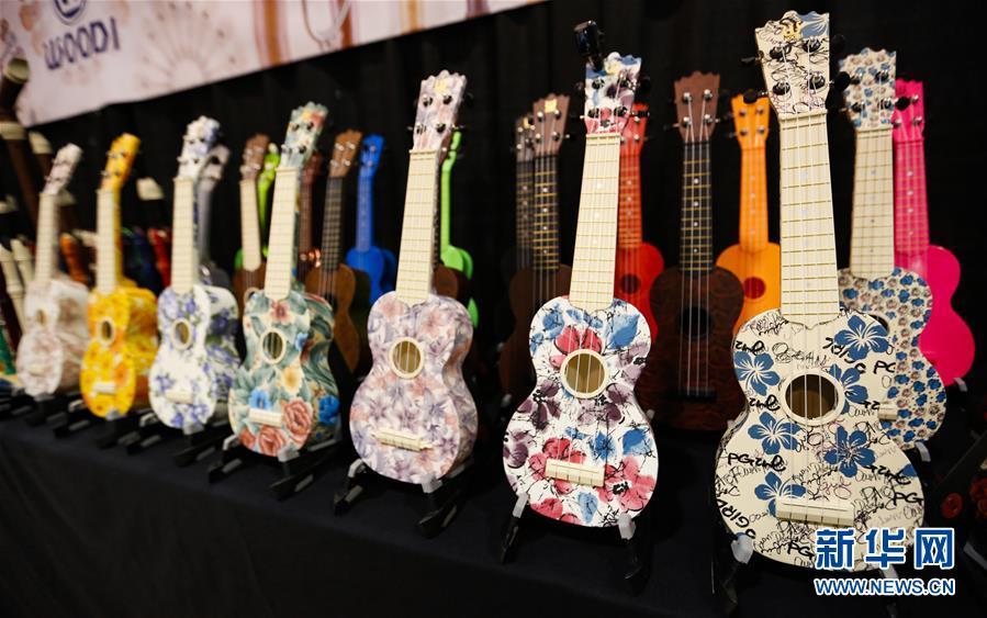 """(国际·图文互动)(5)通讯:中国乐器在美国乐器展上""""奏响强音"""""""