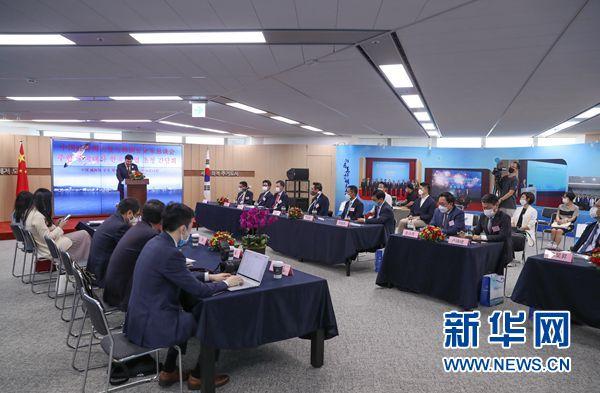 中韩人士:中国引擎助力世界经济复苏