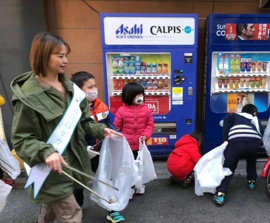 """這些華人志愿者為何在日本""""撿垃圾""""?行勝于言"""