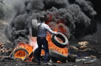 巴勒斯坦示威者就土地問題與以色列軍方發生衝突