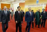 胡錦濤迎接與會外方代表團團長