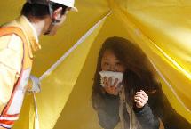 日本舉行地震逃生演練 紀念3.11大地震4周年(組圖)