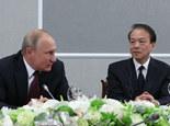 何平在第22屆聖彼得堡國際經濟論壇期間提問普京